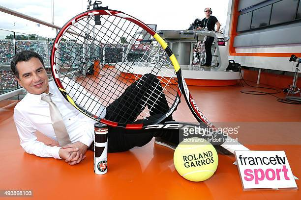 Journalist Laurent Luyat poses at the France Television's studio at the French Open 2014 Day 1 at Roland Garros on May 25 2014 in Paris France