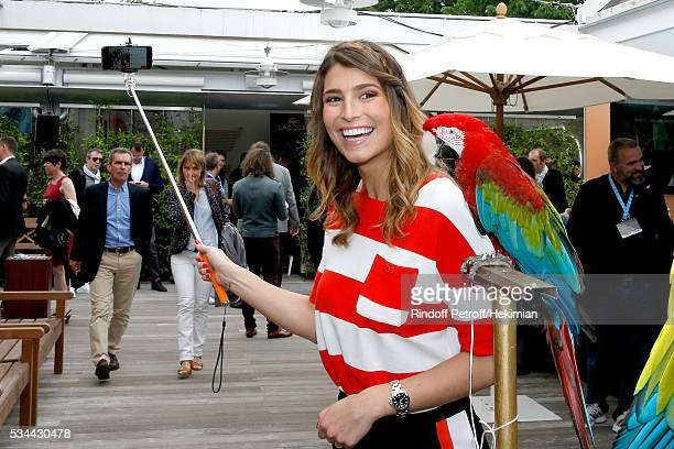 Journalist Laury Thilleman with parrot Arthur attend the 2016 French Tennis Open Day Four at Roland Garros on May 25 2016 in Paris France