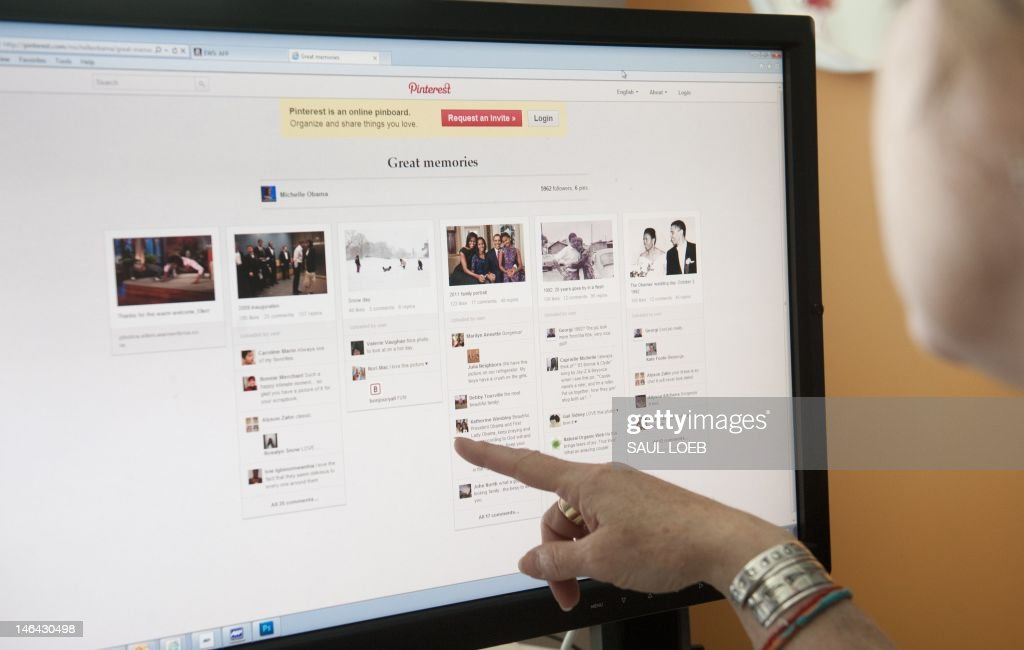 A journalist looks at US First Lady Michelle Obama's Pinterest, a social photo sharing website, as seen on a computer screen in Washington, DC, June 13, 2012. AFP PHOTO / Saul LOEB