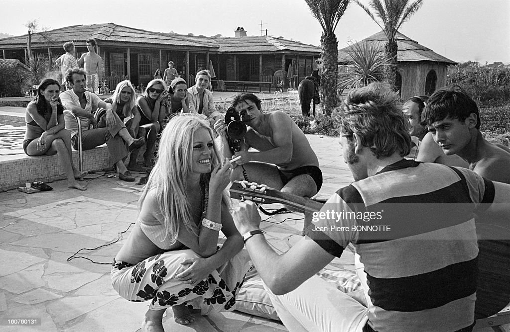 Journalist Marc Francelet filming a party with <a gi-track='captionPersonalityLinkClicked' href=/galleries/search?phrase=Brigitte+Bardot&family=editorial&specificpeople=202903 ng-click='$event.stopPropagation()'>Brigitte Bardot</a> and <a gi-track='captionPersonalityLinkClicked' href=/galleries/search?phrase=Johnny+Hallyday&family=editorial&specificpeople=243155 ng-click='$event.stopPropagation()'>Johnny Hallyday</a> in August, 1967 in Saint-Tropez, France.