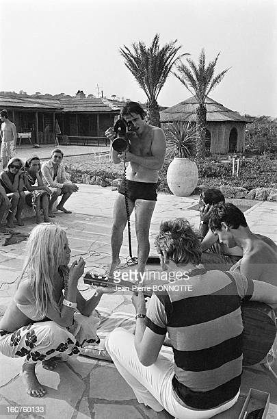 Journalist Marc Francelet filming a party with Brigitte Bardot and Johnny Hallyday in August 1967 in SaintTropez France