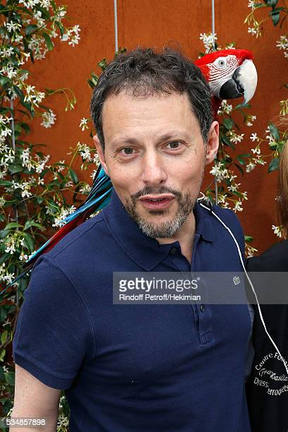Journalist MarcOlivier Fogiel poses with parrot Arthur during Day Seven of the 2016 French Tennis Open at Roland Garros on May 28 2016 in Paris France