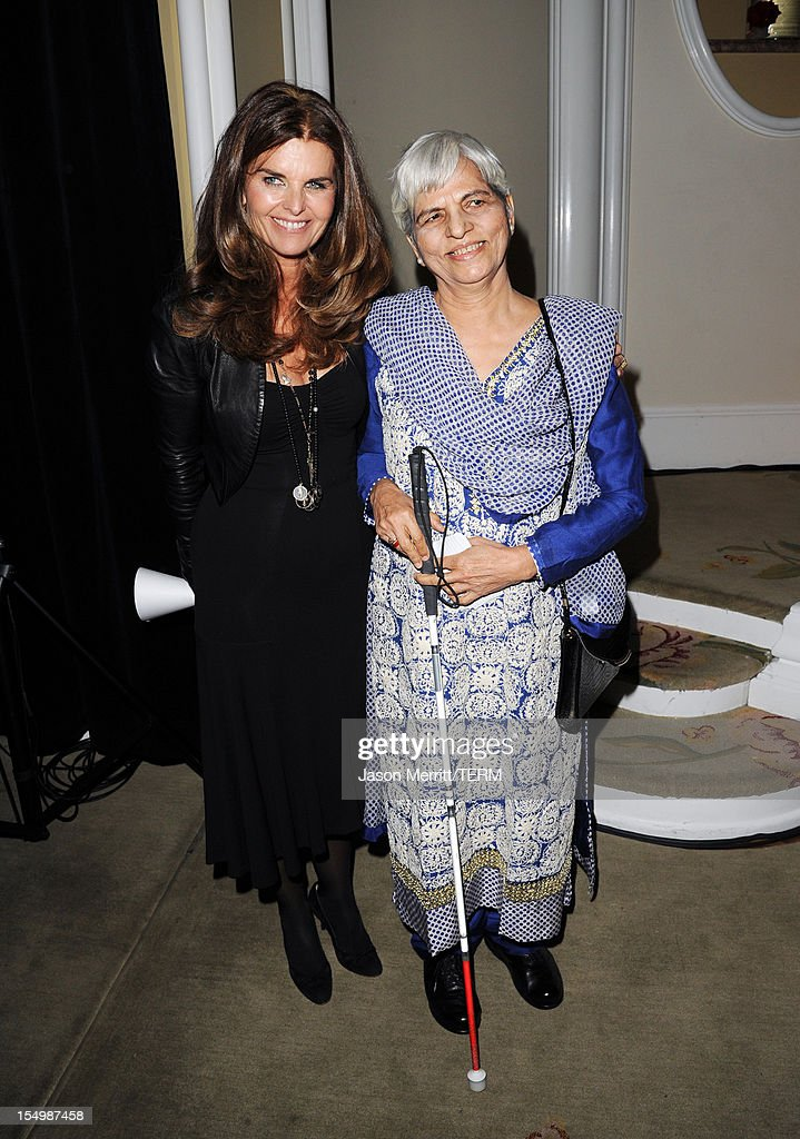 Journalist <a gi-track='captionPersonalityLinkClicked' href=/galleries/search?phrase=Maria+Shriver&family=editorial&specificpeople=179436 ng-click='$event.stopPropagation()'>Maria Shriver</a> and honoree Zubeida Mustafa attend the 2012 Courage in Journalism Awards hosted by the International Women's Media Foundation held at the Beverly Hills Hotel on October 29, 2012 in Beverly Hills, California.