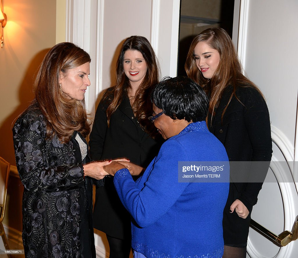 Journalist <a gi-track='captionPersonalityLinkClicked' href=/galleries/search?phrase=Maria+Shriver&family=editorial&specificpeople=179436 ng-click='$event.stopPropagation()'>Maria Shriver</a> (L) and Lifetime Achievement Award winner Edna Machirori attend the International Women's Media Foundation's 2013 Courage in Journalism Awards at the Beverly Hills Hotel on October 29, 2013 in Beverly Hills, California.
