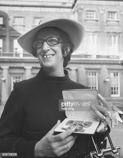 Journalist Marjorie Proops pictured holding her OBE after receiving the investiture at Buckingham Palace London November 25th 1969