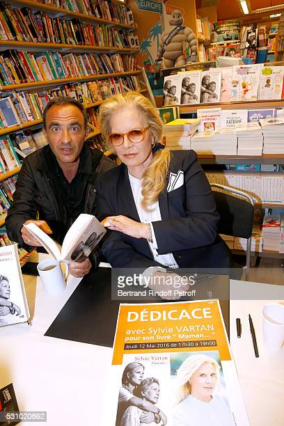 Journalist Nikos Aliagas and singer Sylvie Vartan attend Sylvie Vartan signs her Book 'Maman' at Librairie Lamartine on May 12 2016 in Paris France