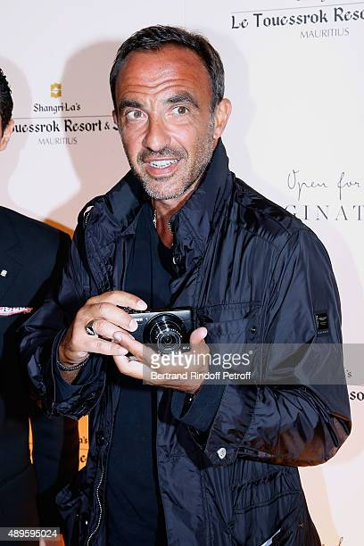 Journalist Nikos Aliagas taking pictures attends 'ShangriLa Hotels and Resorts' presents its new Hotel in Mauritius 'Le Touessrok Resort and Spa'...