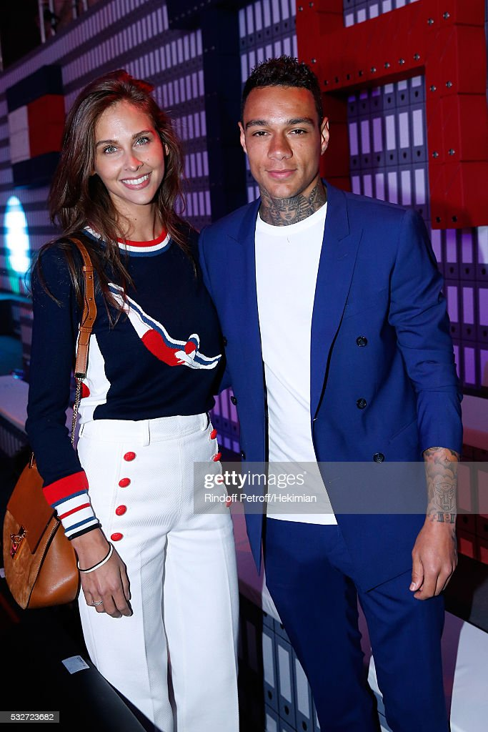 Journalist Ophelie Meunier and football player Gregory van der Wiel attend Tommy Hilfiger Hosts Tommy X Nadal Party - Cocktail on May 18, 2016 in Paris, .