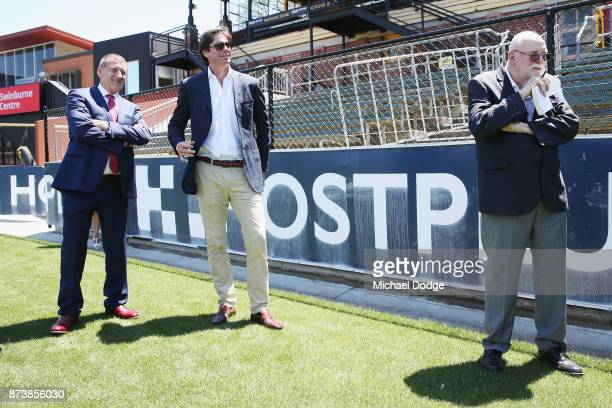 Journalist Patrick Smith listens next to incoming Hawks President Jeff Kennett and AFL CEO Gillon McLachlan during his book launch for 'Patrick...