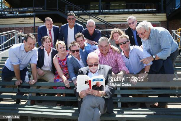 Journalist Patrick Smith poses with family friends and heavyweights from media and the AFL during his book launch for 'Patrick Smith's Sport Best of...