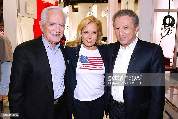 Journalist Philippe Labro Main Guest singer Sylvie Vartan and presenter of the show Michel Drucker attend the 'Vivement Dimanche' French TV Show held...