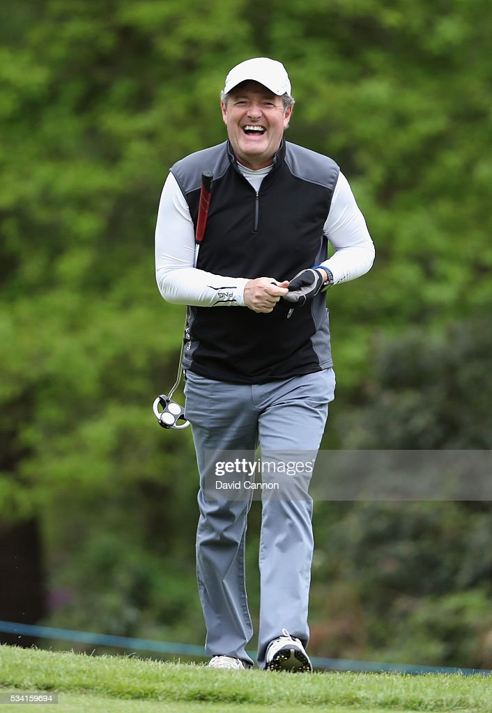 Journalist <a gi-track='captionPersonalityLinkClicked' href=/galleries/search?phrase=Piers+Morgan&family=editorial&specificpeople=216509 ng-click='$event.stopPropagation()'>Piers Morgan</a> laughs during the Pro-Am prior to the BMW PGA Championship at Wentworth on May 25, 2016 in Virginia Water, England.