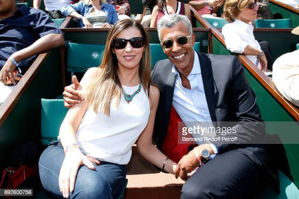 Journalist Rachid M'Barki and his companion Bouchra attend the 2017 French Tennis Open Day Height at Roland Garros on June 4 2017 in Paris France