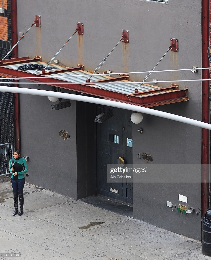 A Journalist reports outside Nightclub Avenue on November 29, 2012 in New York City. Lindsay Lohan was charged with third-degree assault after being taken to the 10th precinct following an alleged assault on woman at club Avenue NYC early this morning.