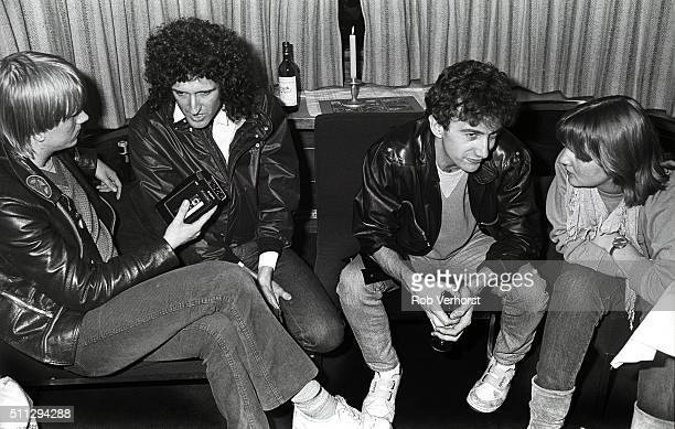Journalist Rogier van Bakel Brian May and John Deacon of Queen and journalist Annemarie den Daas on board a train from Leiden to Amsterdam...