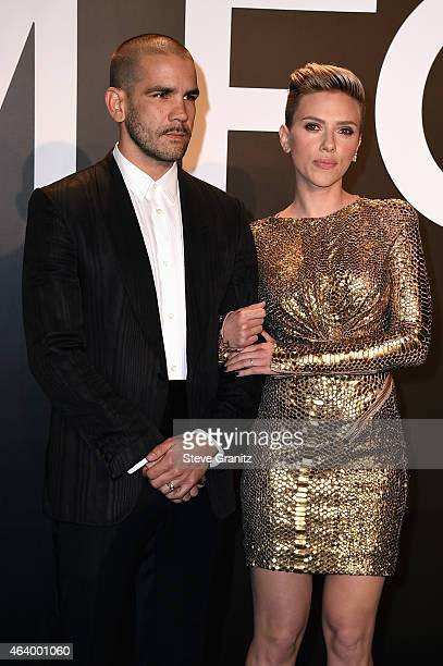 Journalist Romain Dauriac and actress Scarlett Johansson attend the TOM FORD Autumn/Winter 2015 Womenswear Collection Presentation at Milk Studios in...