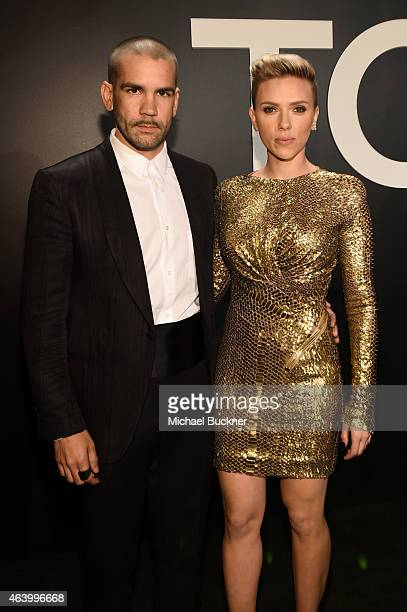 Journalist Romain Dauriac and actress Scarlett Johansson both wearing TOM FORD attend the TOM FORD Autumn/Winter 2015 Womenswear Collection...