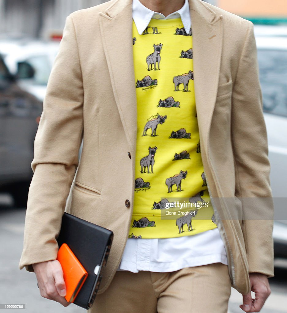 Journalist Simone Marchetti is seen during Milan Fashion Week on January 15, 2013 in Milan, Italy. Detail of the Au Jour Le Jour Garcon sweater.