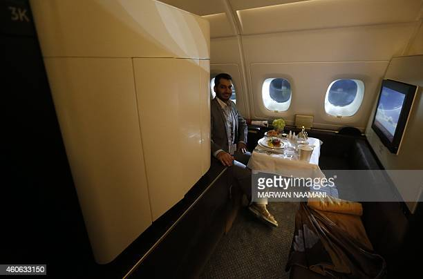 A journalist sits in one of the first class apartments on the Etihad Airways Boeing B787 at Abu Dhabi airport on December 18 2014 after the Abu...