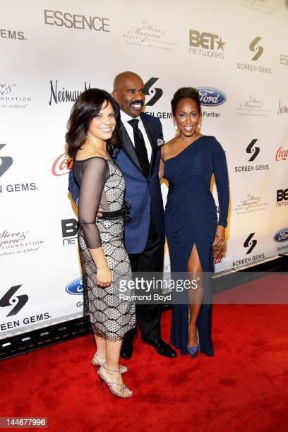 CNN journalist Soledad O'Brien comedian Steve Harvey and his wife Marjorie poses for photos on the red carpet during the Steve Marjorie Harvey...