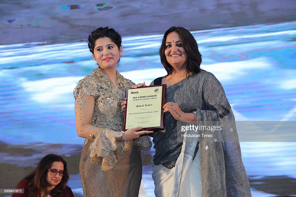 Journalist Sonal Kalra receives award from entrepreneur Harbeen Arora during Women Economic Forum event hosted by ALL Ladies League at Pullman-Novotel Hotel on May 20, 2016 in New Delhi, India.