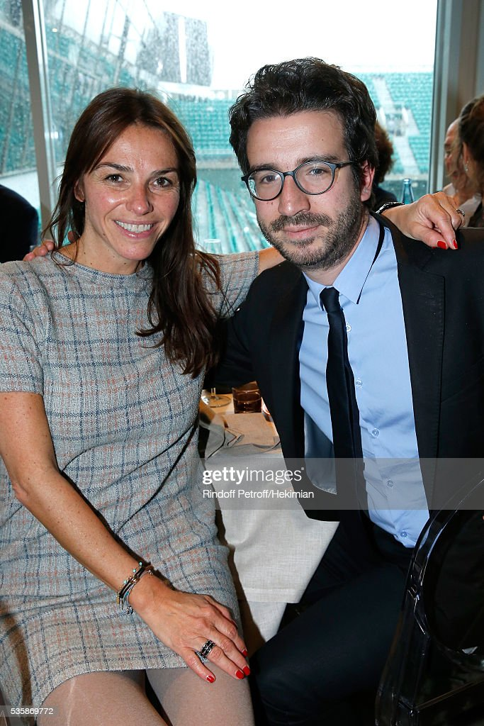 Journalist Sophie le Saint and Chief of Staff of Delphine Ernotte, President of France Televisions, Stephane Sitbon-Gomez attend Day Nine of the 2016 French Tennis Open at Roland Garros on May 30, 2016 in Paris, France.