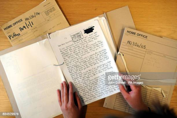 A journalist studies one of the 593 files of the Myra Hindley moors murder case which has just been released after 30 years into the public domain