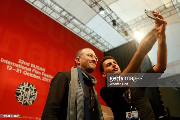 A journalist take selfies with American director Darren Aronofsky after the official press conference for 'mother' during the Busan International...
