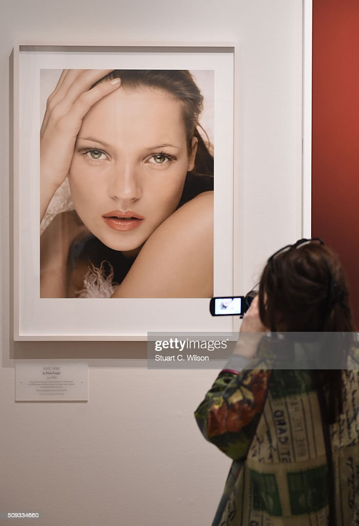 A journalist takes a picture at the press preview for 'Vogue 100: A Century of Style' exhibiting the photographs that has been commissioned by British Vogue since it was founded in 1916 at National Portrait Gallery on February 10, 2016 in London, England.