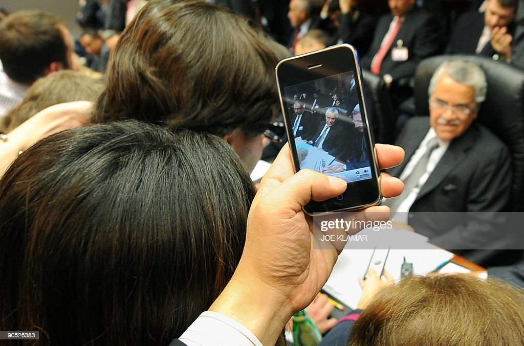 A journalist takes pictures with his iPhone of Saudi Arabia's Minister of petroleum and mineral resources Ali I Naimi as he attends the 154th regular OPEC meeting in Vienna on September 9,2009.. OPEC oil producing countries have reached a 'consensus' to hold crude output unchanged, Kuwait's oil minister said ahead of Wednesday night's meeting of the cartel.