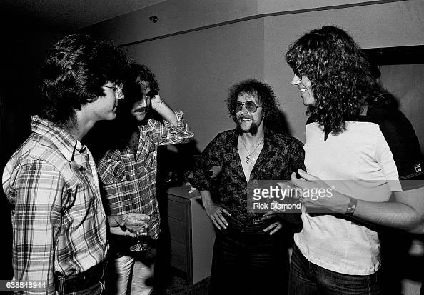 Journalist Tony Paris Tom Lanzillotti CBS Records Kelly Groucutt and Jeff Lynne of ELO attend press reception at the Peachtree Plaza in Atlanta...