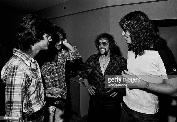 Journalist Tony Paris Tom Lanzillotti CBS Records Kelly Groucutt and Jeff Lynne of ELO attend press reception at the Peachtree Plaza in Atlanta...