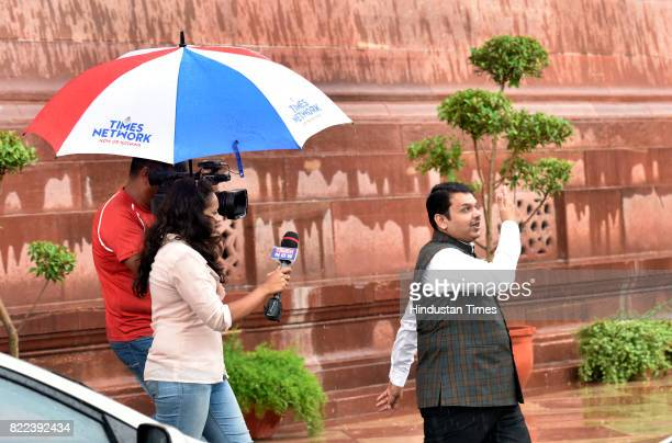 TV journalist tries to take sound bite of Maharashtra Chief Minister Devendra Fadnavis after swearingin ceremony of President Ram Nath Kovind at...