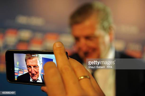 A journalist uses a smartphone to record an interview with England manager Roy Hodgson after the Final Draw for the 2014 FIFA World Cup Brazil at...