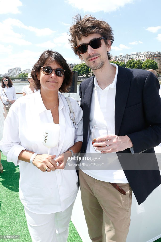 Journalist Valerie Expert and director Hugo Gelin attends 'Brunch Blanc' hosted by Groupe Barriere for Sodexho with a cruise in Paris on June 30, 2013, France.