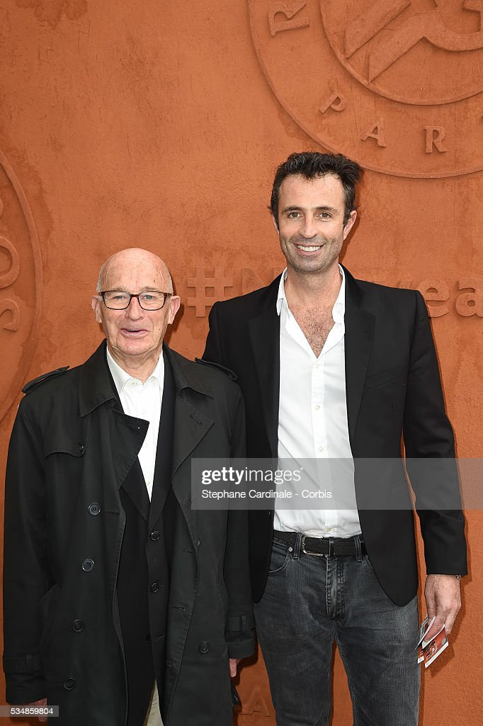 Journalist Victor Robert (R) and his father attend day seven of the 2016 French Open at Roland Garros on May 28, 2016 in Paris, France.