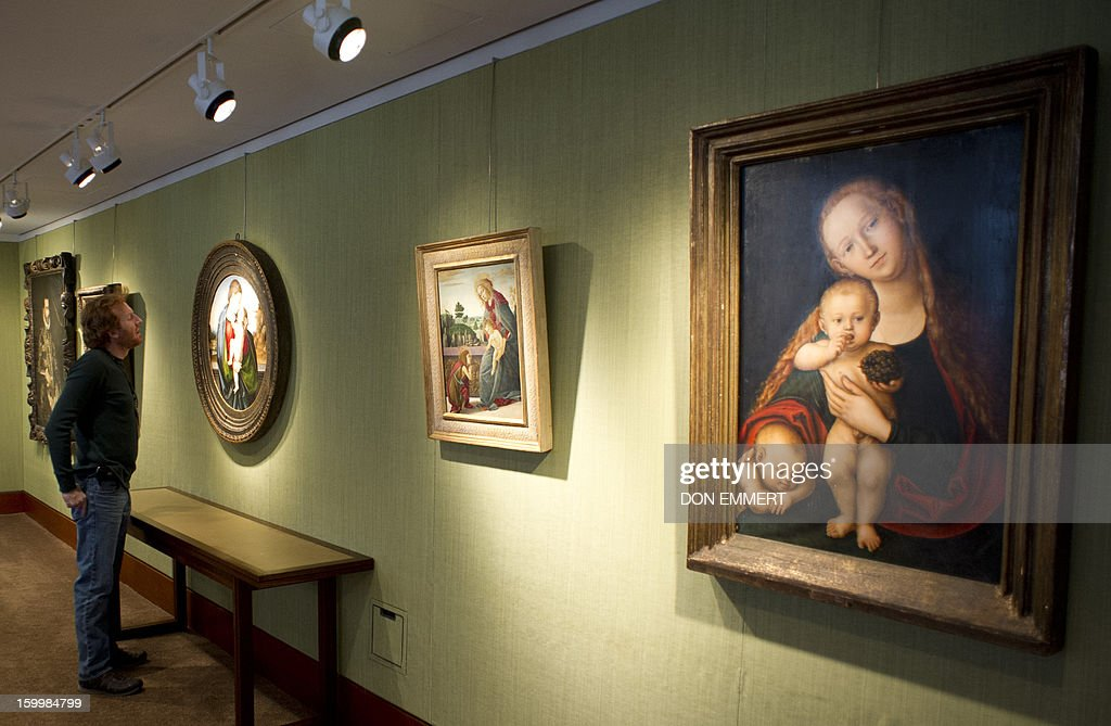 A journalist views 'The Madonna and Child' by Fra Bartolommeo January 24, 2013 at Christie's in New York. The painting is one of the works scheduled to be auctioned during Old Masters week January, 26-31, 2013. AFP PHOTO/DON EMMERT