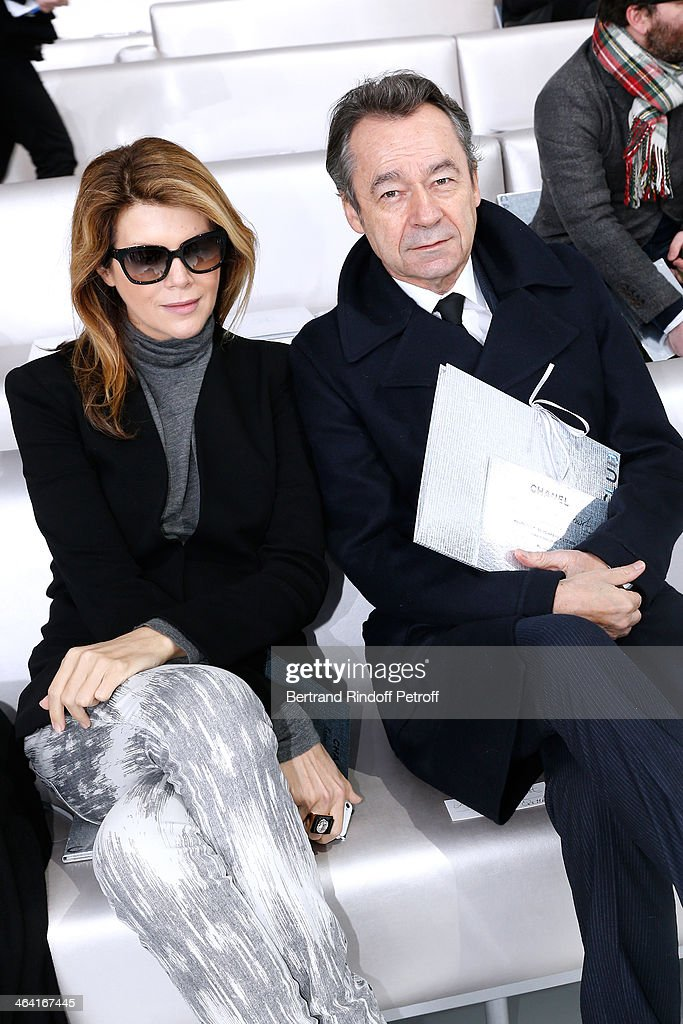 Journalist Virginie Mouzat and Chief Editor of Vanity Fair France, <a gi-track='captionPersonalityLinkClicked' href=/galleries/search?phrase=Michel+Denisot&family=editorial&specificpeople=753821 ng-click='$event.stopPropagation()'>Michel Denisot</a> attend the Chanel show as part of Paris Fashion Week Haute Couture Spring/Summer 2014 on January 21, 2014 in Paris, France.