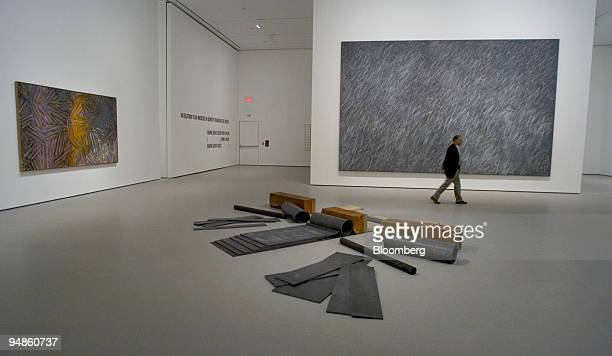 A journalist walks through a gallery in The Museum of Modern Art MoMA during a press preview in New York on November 15 2004 'Between the Clock and...