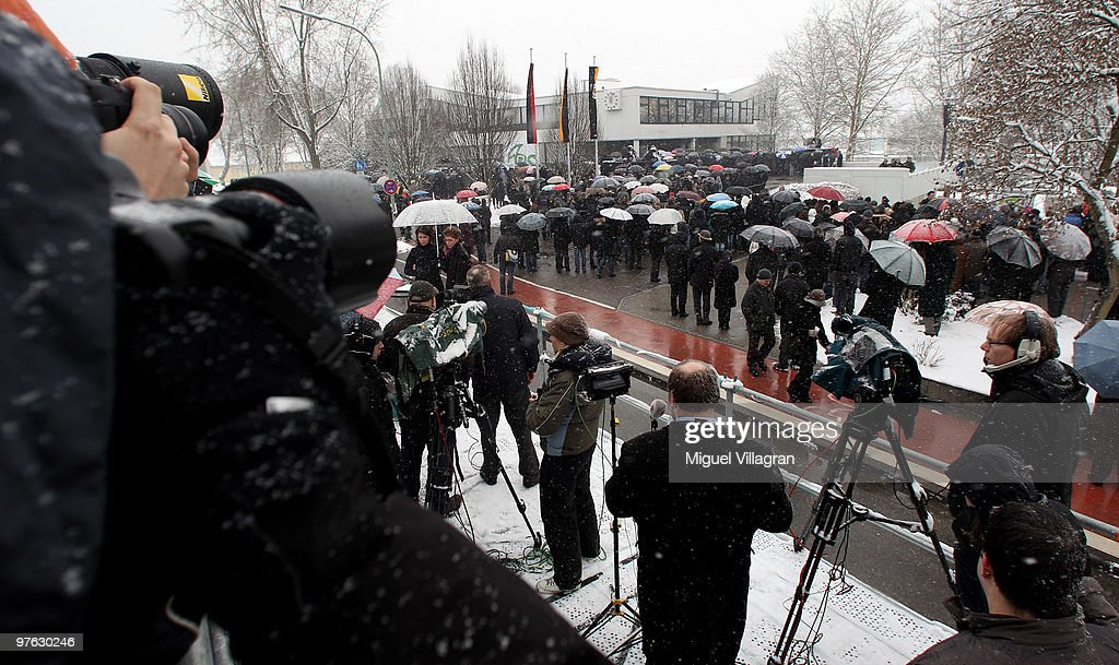 Journalist watch the commemoration ceremony in front of the Albertville School on March 11 2010 in Winnenden Germany Tim Kretschmer opened fire on...
