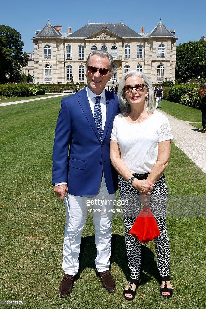 Journalist William Leymergie and his wife Marie attend the Christian Dior show as part of Paris Fashion Week Haute Couture Fall/Winter 2015/2016 on July 6, 2015 in Paris, France.