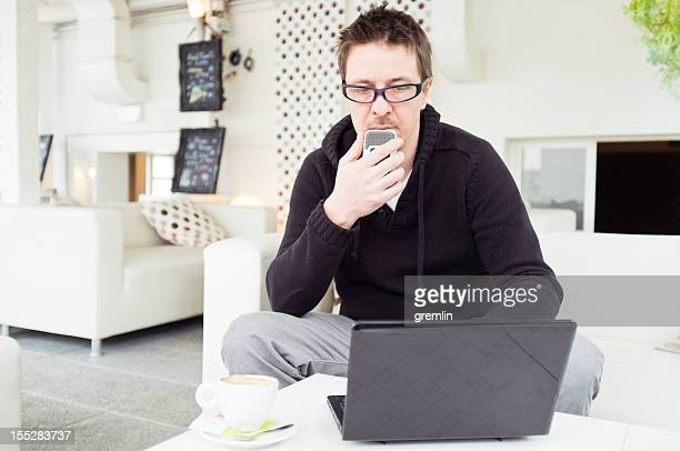 Journalist with laptop and dictaphone