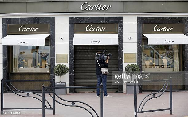 A journalist works in front of the Cartier jewellery shop on the Croisette in Cannes French Riviera on May 5 after the hold up by four armed men who...