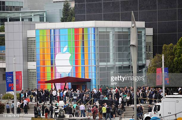 Journalists and attendees line up outside of Yerba Buena Center for the Arts in San Francisco to attend Apple's special media event to introduce the...