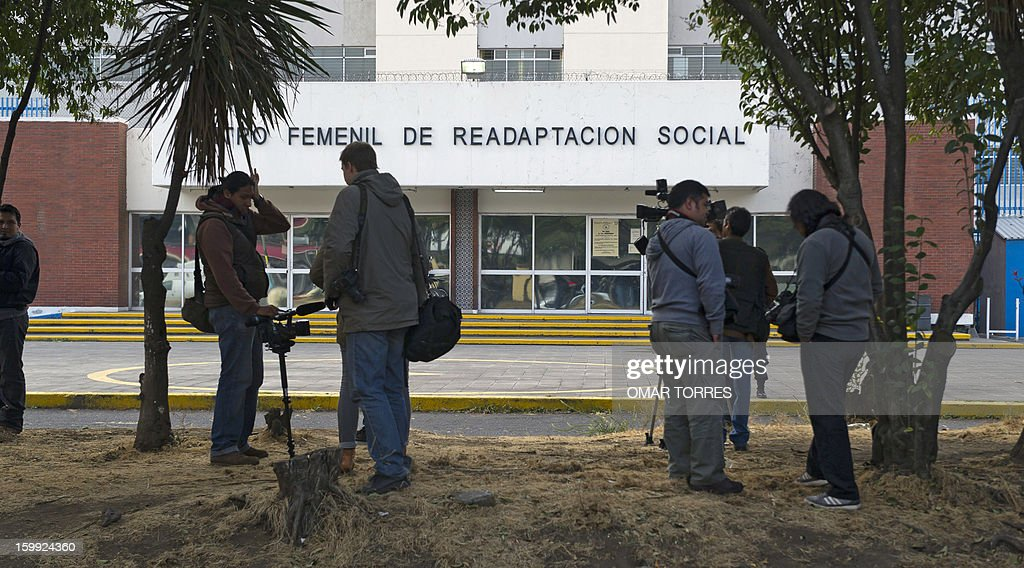 Journalists and cameramen wait outside the Tepepan prison in Mexico City for the arrival of French Florence Cassez's father, Bernard Cassez, on January 23, 2013. Mexican Supreme court will take Wednesday a new resolution about the situation of Florence Cassez, sentenced to 60 years of imprisonment in Mexico.