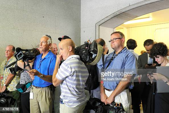 Journalists and crews of media evacuate from the press briefing room of the White House due to a bomb threat on June 9 2015 in Washington DC