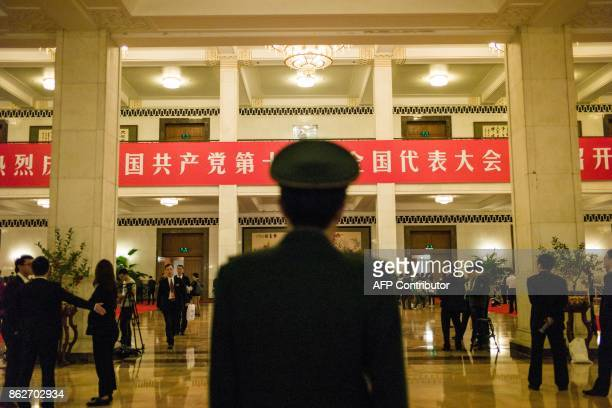 Journalists and delegates wait in the main hall during the speech of China's President Xi Jinping at the Communist Party's 19th Congress in Beijing...