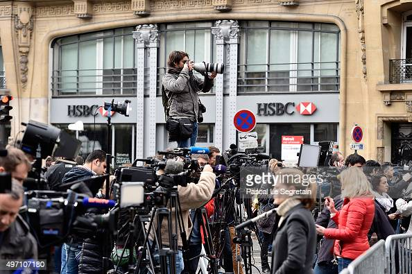 Journalists and members of the media gather near the Bataclan concert hall on November 14 2015 in Paris France At least 120 people have been killed...