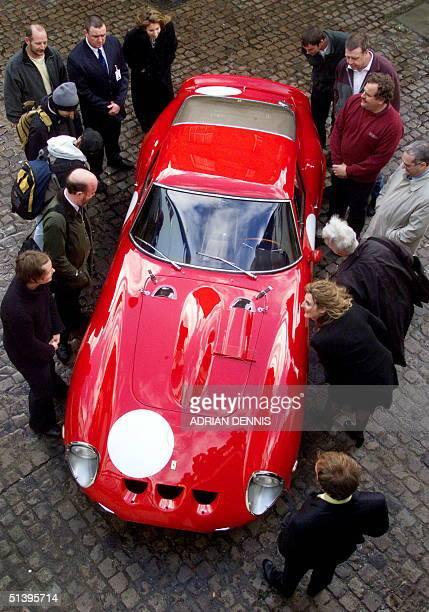 Journalists and pedestrians peer inside a vintage 1963 Ferrari 250 GTO which won the 1963 Le Mans GT race outside Bonham and Brooks auction house in...