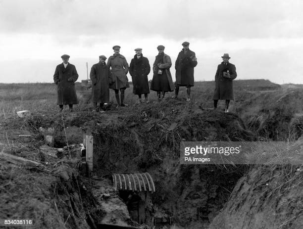 Journalists and photographers from various news agencies are shown a machine gun post in an abandoned German trench part of the series of...